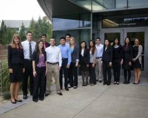 Students in front of The School of Management at Binghamton University, State University of New York.